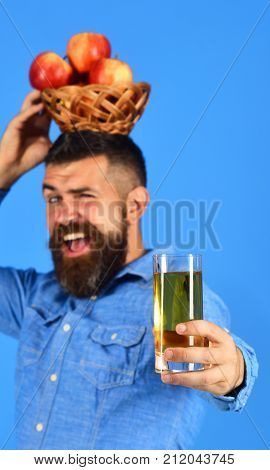 Farmer With Cheerful Face Holds Fresh Apple Juice And Apples