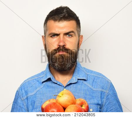 Man With Beard Holds Red Apples Isolated On White Background.