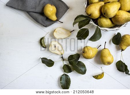 yellow pears on a white background top view