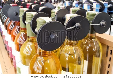 RFID hard tag isolated - Shoplifting and anti-theft system - Electronic Article Surveillance system used with high-value goods - Alcoholic drinks bottle