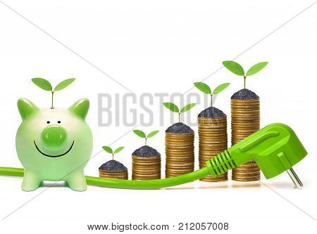 Green piggy bank with stacks of golden coins and green plug - Living Green and Saving Energy