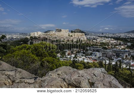 view from the philopappos hill of the acropolis and in the background the hill lycabettus