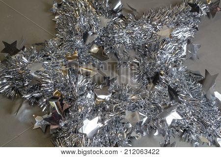 Silvery tinsel with stars as decoration for Christmas