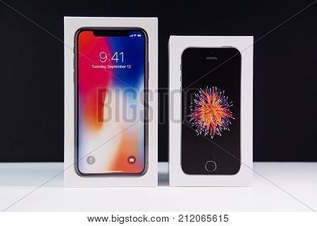 PARIS FRANCE - NOV 3 2017: Unboxing unpacking of the latest Apple iPhone X 10 smartphone next to iphone SE box