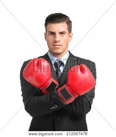 Businessman in boxing gloves on white background