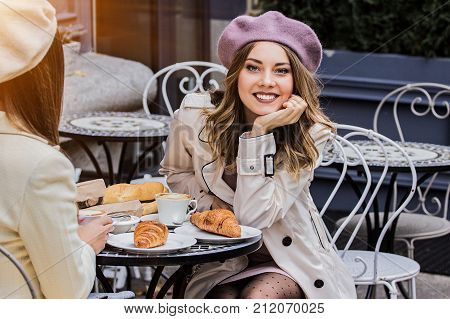 Beautiful French Woman In Cafe.
