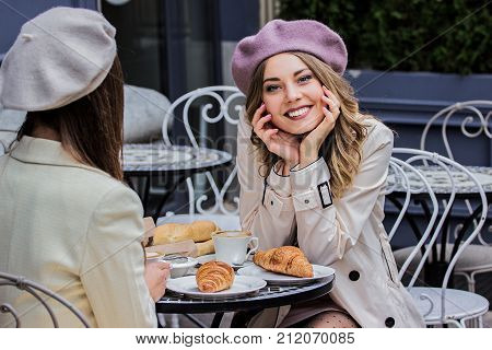 Cute And Beautiful French Woman In Cafe.