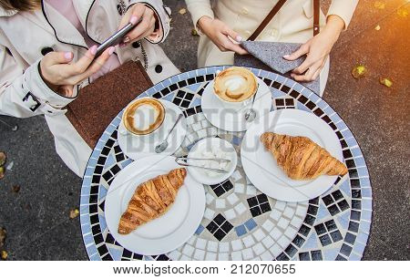 Best Friends Meeting. Women Sitting In French Cafe