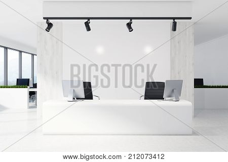 White Reception Desk In A White Office