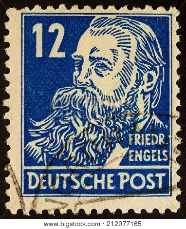 Moscow Russia - November 03 2017: A stamp printed in Germany shows portrait of Friedrich Engels (1820-1895) circa 1948