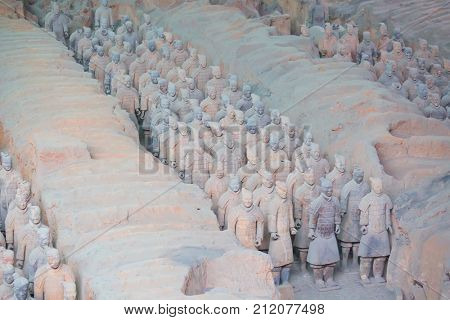 XIAN, CHINA - October 8, 2017: Famous Terracotta Army in Xi'an, China. The mausoleum of Qin Shi Huang, the 1st Emperor of China is collection of terracotta sculptures of the armored men and horses.