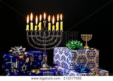 Hanukkah menorah with candles lit Nine burning candles on blurred background. Hanukkah concept