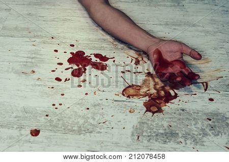 Hand In Blood On A Floor