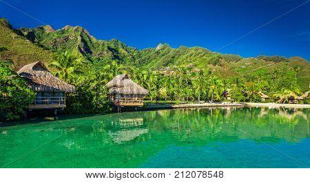 Over water bungalows and an amazing green lagoon at Moorea, Tahiti