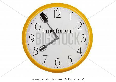 Yellow kitchen wall clock reminding about meal time