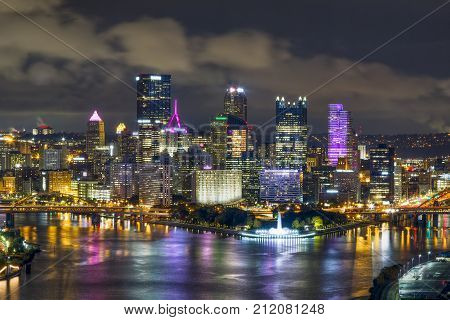 The city of Pittsburgh Pennsylvania shines at night where the Allegheny and Monongahela Rivers meet to form the mighty Ohio.