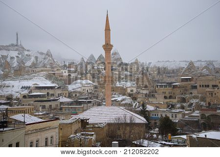 GOREME, TURKEY - JANUARY 07, 2015: Goreme in snowfall in the gloomy January afternoon