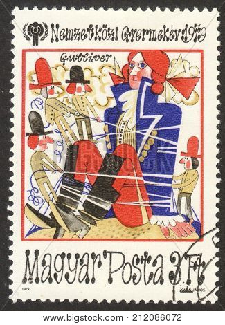 MOSCOW RUSSIA - CIRCA OCTOBER 2017: a post stamp printed in HUNGARY shows illustration of Gulliver's travels the series