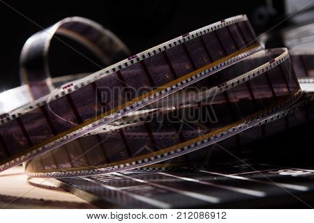 Old Film With A Movie On A Dark Background