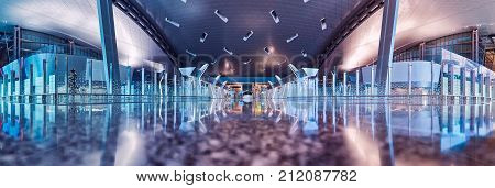 Doha Qatar - November 2017: Interior shot of departure terminal of Hamad International Airport. The international airport of Doha home of Qatar airways. Creative and high quality image. Panoramic view.