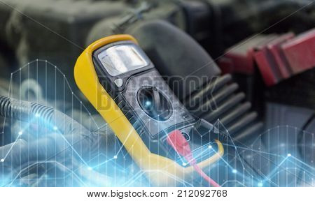 auto service, repair and maintenance concept - digital multimeter or voltmeter testing car battery