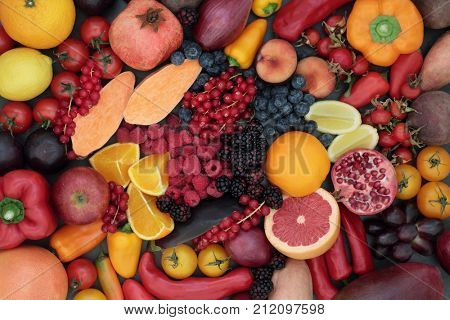 Healthy eating super food concept promoting good health with fruit and vegetables high in anthocyanins, antioxidants and vitamins. Top view.
