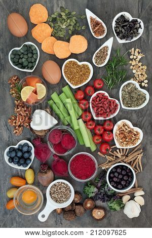 Healthy diet food concept to improve brain power and cognitive functions on marble background. Super foods high in minerals, vitamins, antioxidants, omega 3 and anthocyanins. Top view.