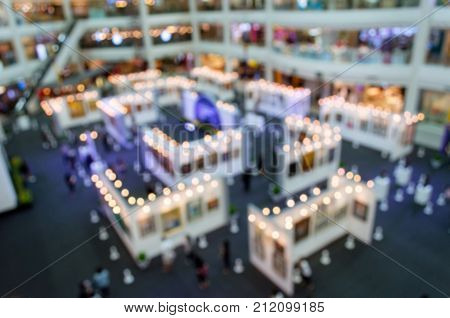 top view blurred image of event hall at shopping mall or public event exhibition hall big sale promotion black friday business trade show concept vintage color tone