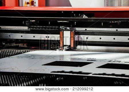 Metal sheet punching machine, closeup view of metal processing