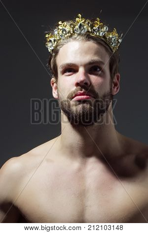 Drag queen homosexual and trans. Freak gay and transvestite with naked chest. Man or cinderella prince in crown on grey background. Fashion jewelry accessory. Glory nobility triumph concept. poster