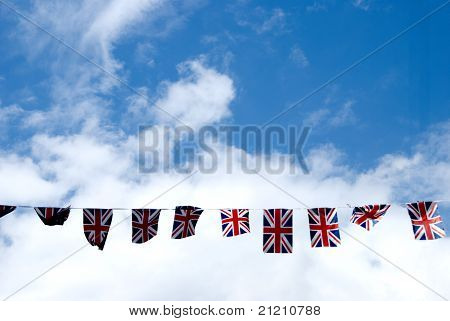 A String of Union Jack Flags across the main street in Haworth Yorkshire poster