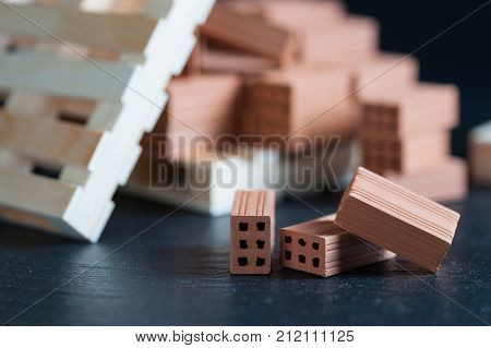 Clay bricks used for close-up miniature on black background poster