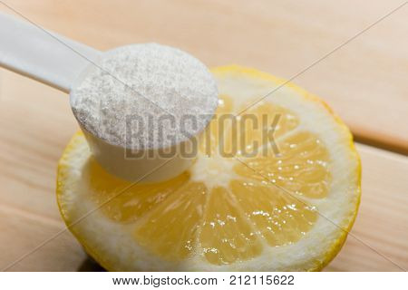 Sport Supplement Or Vitamin With A Lemon Slice. Sport Nutrition Concept.