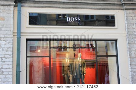 TALLINN, ESTONIA - OCTOBER 27, 2017: Hugo Boss Fashion Store Window. German Luxury Clothing Shop, also called BOSS, is a Famous Company Selling Men, Women and Children Clothes. Outdoor showcase view.