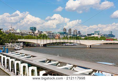 River Thames, London, England, Embankment Pier and Waterloo Bridge