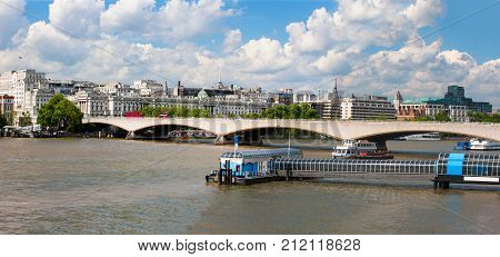 River Thames, London, England, eastern skyline with Festival Pier and Waterloo Bridge