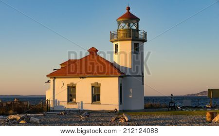 A lighthouse stands on Alki Point in the Puget Sound near Seattle