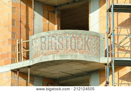 Residential building construction site close up of apartment brick terrace balcony