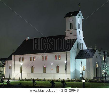 REYKJAVIKICELAND/OCTOBER 312017: Domkirkjan-Reykjavik Lutheran Cathedral at night. Domkirkjan was first officially endorsed by the Lutheran church of Iceland.