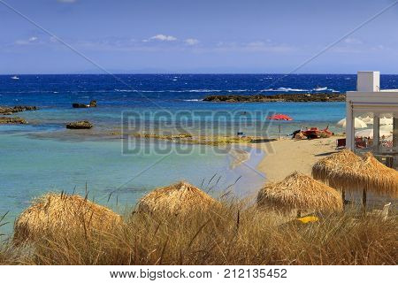 Summer seascape, Apulia coast: Otranto beach. Salento is characterized by a alternation of sandy coves and jagged cliffs overlooking a truly clear and crystalline sea.