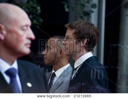 LONDON, UK - JUNE 21: Jenson Button and Lewis Hamilton at the official opening of the new McLaren showroom on Knightsbridge on June 21, 2011 in London, UK.