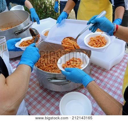 Meal Distribution With Pasta And Tomato Sauce In The Canteen