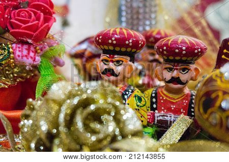 Beautifully made traditional rajasthani puppets showing a bridal ceremony. The puppet for the bride, the musicians are shown in the traditional dresses