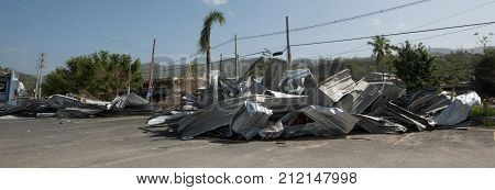 Remains of aluminum roof destroyed by Hurricane Maria outside San Juan.