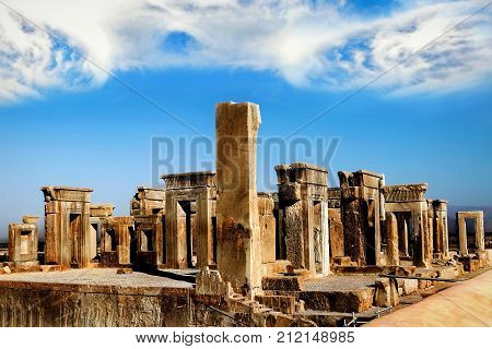 Persepolis is the capital of the ancient Achaemenid kingdom. Sight of Iran. Ancient Persia. Blue sky and clouds baclground.