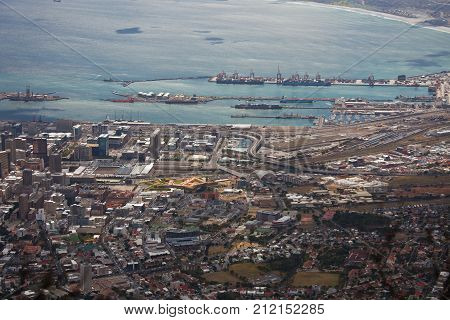 Top view of the seaport and the Bay in Cape town. The pier cranes ships and containers at the port of Cape town. South Africa