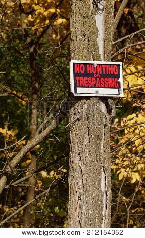 No hunting or trespassing sign in the woods