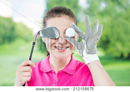 Funny Portrait Of Happy Golfers With An Eye Ball Isolated On A Background Of Golf Courses