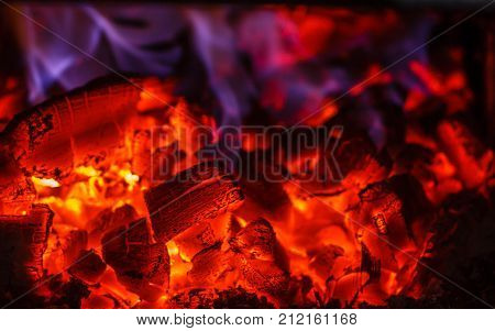 Glowing embers in hot red color close up