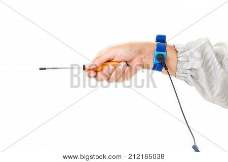Bracelet on the hand of a man wearing ESD cloth holding a screwdriver static resistance (ESD) bracelet or ground equipment anti-static used to safely ground is working. electronic devices